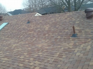 Storm damaged shingles repaired by Ruiz Roofing